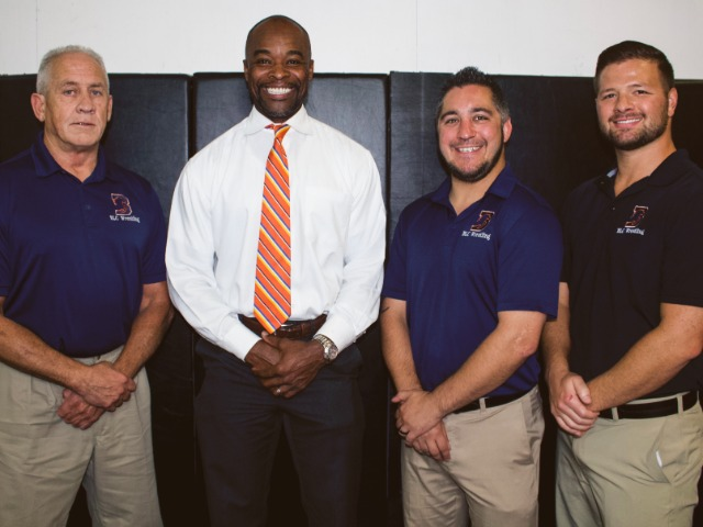 The 2018-2019 BLC Wrestling Coaching Staff with President Gilbert