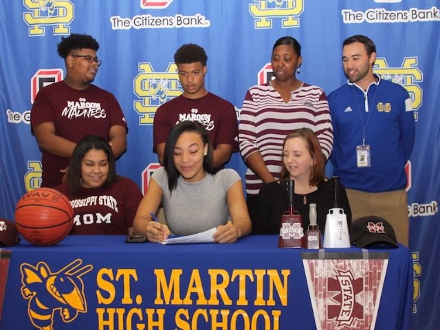 Center Daphne White signs her NCAA Letter of Intent with Mississippi State along side Head Coach Gina Bell.