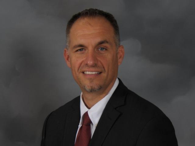 staff photo of Adam Cook