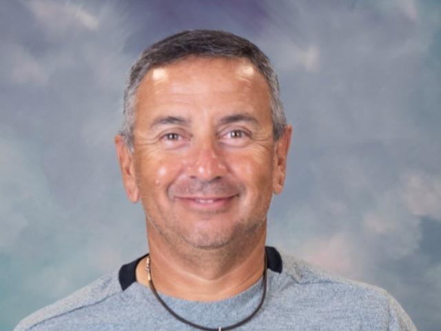 staff photo of Tom  Dela Garza